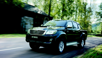 Picture of a driving Toyota Hilux 4x4 Turbo Diesel